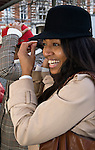 BRUSSELS - BELGIUM - 08 JANUARY 2012 -- Marolles the bohemian city part of Brussels. -- The most famous flee-market of Brussels on Place Jeu de Balle. Onenia Abrancaes having fun trying on hats in the hatshop opposite the fleemarket -- PHOTO: Juha ROININEN /  EUP-IMAGES
