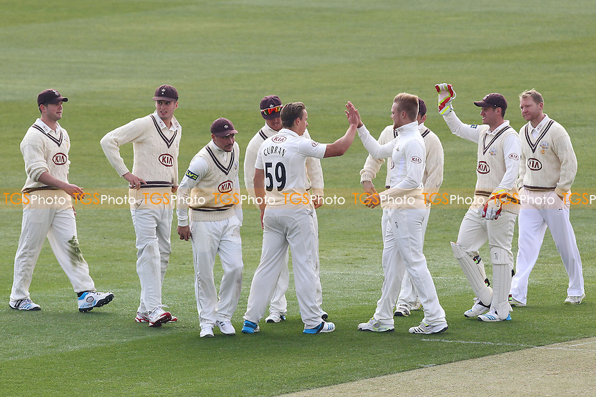 Tom Curran (59) of Surrey is congratulated on the wicket of Jaik Mickleburgh - Essex CCC vs Surrey CCC - Pre-Season Friendly Cricket Match at the Essex County Ground, Chelmsford - 27/03/14 - MANDATORY CREDIT: Gavin Ellis/TGSPHOTO - Self billing applies where appropriate - 0845 094 6026 - contact@tgsphoto.co.uk - NO UNPAID USE