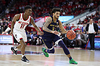 RALEIGH, NC - JANUARY 9: Prentiss Hubb #3 of the University of Notre Dame is chased by Juwan Durham #11 of North Carolina State University during a game between Notre Dame and NC State at PNC Arena on January 9, 2020 in Raleigh, North Carolina.