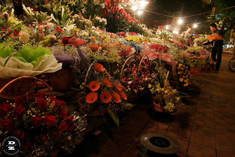A market along Pho Cat Bu in Haiphong, Vietnam has been selling flowers to customers for many years.  Haiphong, the third largest city in Vietnam, is an important seaport and industrial center for the country.  Photograph by Douglas ZImmerman