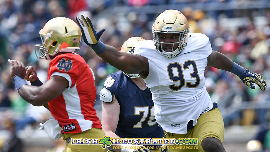 Defensive lineman Jay Hayes (93) pressures quarterback Brandon Wimbush (7) in the second quarter.