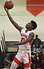 Julius Goddard #21 of Amityville drives to the net during a Suffolk County League VI varsity boys basketball game against Wyandanch at Amityville High School on Tuesday, Jan. 2, 2018. Amityville won by a score of 95-50.