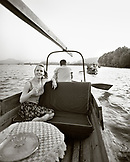 CHINA, Hangzhou, portrait of smiling young woman taking a tour of West Lake (B&W)