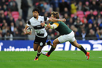 Melani Nanai (Blues) of Barbarians forces his way past Patrick Lambie of South Africa during the Killik Cup match between Barbarians and South Africa at Wembley Stadium on Saturday 5th November 2016 (Photo by Rob Munro)