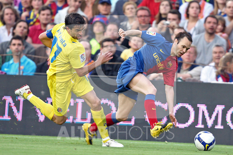 Barcelona's Andres Iniesta against Villarreal's Jav Venta during La Liga match, May 10th, 2009. .(ALTERPHOTOS/Susan Park).