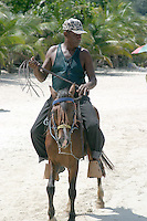 Horseback rides are offered on the beach at West Bay, Roatan, Honduras.