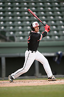 Second baseman Dawson Price (12) of the North Greenville Crusaders bats in a game against the Queens University Royals on Tuesday, March 12, 2019, at Fluor Field at the West End in Greenville, South Carolina. North Greenville won, 14-3. (Tom Priddy/Four Seam Images)
