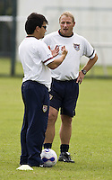USA assistant coach Bret Hall talks to scout Dean Duerst during practice at Shenhua FC in Shanghai, China, on September 25, 2007.