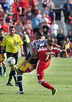 July 20, 2013: New York Red Bulls forward Thierry Henry #14 and Toronto FC defender Steven Caldwell #13 in action during a game between Toronto FC and the New York Red Bulls at BMO Field in Toronto, Ontario Canada.<br /> The game ended in a 0-0 draw.