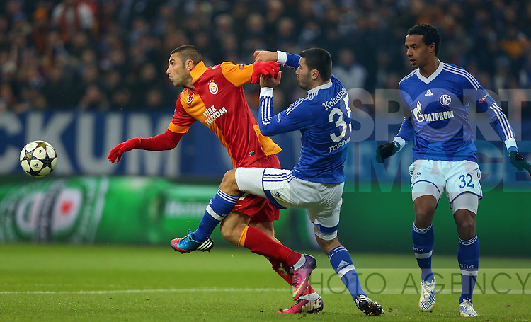 UEFA Champions League second match between Schalke 04 and Galatasaray at Veltins arena in Gelsenkirchen, Germany 12.03.2013.Pictured: Burak Yilmaz of Galatasaray and Sead Kolasinac and Joel Matip of Schalke 04.