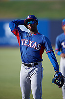 AZL Rangers infielder Keithron Moss (3) warms up before an Arizona League game against the AZL Brewers Blue on July 11, 2019 at American Family Fields of Phoenix in Phoenix, Arizona. The AZL Rangers defeated the AZL Brewers Blue 5-2. (Zachary Lucy/Four Seam Images)