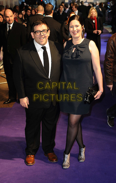 "NICK FROST & wife MARIANGELA.The ""Paul"" UK Film Premiere, Empire Cinema, Leicester Square, London, England, UK, 7th February 2011.full length black suit blue dress couple glasses brown shoes sleeveless married husband.CAP/WIZ.? Wizard/Capital Pictures."