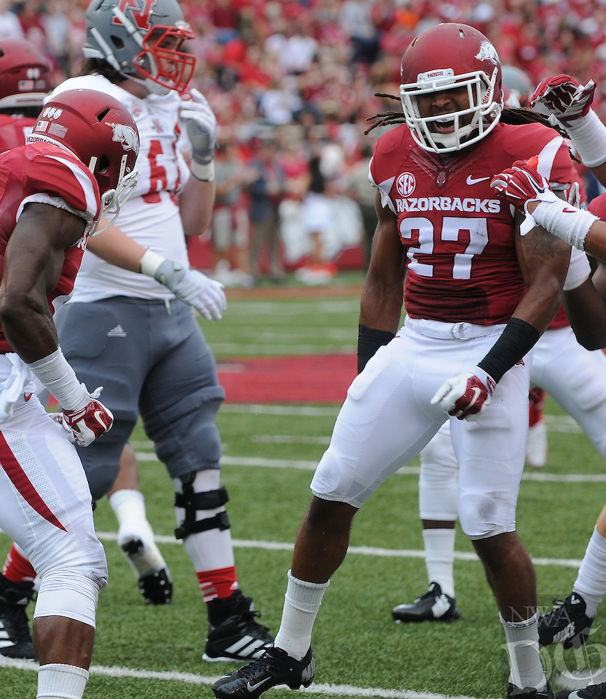 STAFF PHOTO ANTHONY REYES • @NWATONYR<br /> Alan Turner, Razorbacks safety, celebrates a bit hit against Nicholls State in the first quarter Saturday, Sept. 6, 2014 at Razorback Stadium in Fayetteville.