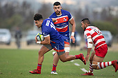 Joshua Gray heads back infield past Rodney Tongotea. Counties Manukau Premier Club Rugby Semi-final game between Ardmore Marist and Karaka, played at Bruce Pulman Park Papakura, on Saturday July 14th 2018.<br /> Ardmore Marist won the game 53 - 8 after leading 22 - 3 at halftime. <br /> Photo by Richard Spranger.