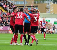 Lincoln City players, from left, Jason Shackell, Michael Bostwick and Harry Toffolo unsuccessfully appeal to Referee Carl Boyeson for a penalty<br /> <br /> Photographer Chris Vaughan/CameraSport<br /> <br /> The EFL Sky Bet League One - Lincoln City v Bristol Rovers - Saturday 14th September 2019 - Sincil Bank - Lincoln<br /> <br /> World Copyright © 2019 CameraSport. All rights reserved. 43 Linden Ave. Countesthorpe. Leicester. England. LE8 5PG - Tel: +44 (0) 116 277 4147 - admin@camerasport.com - www.camerasport.com