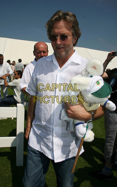 ERIC CLAPTON.Eric Clapton Eleven vs The Bunburys celebrity cricket match at Cranleigh School near Guildford, England,.8th June 2008..half length mascot cuddly toy sunglasses beard stubble white shirt.CAP/DS.©Dudley Smith/Capital Pictures