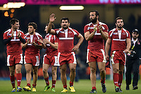 Simon Maisuradze and the rest of the Georgia team acknowledge the crowd after the match. Rugby World Cup Pool C match between New Zealand and Georgia on October 2, 2015 at the Millennium Stadium in Cardiff, Wales. Photo by: Patrick Khachfe / Onside Images