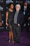 HOLLYWOOD, CA - JANUARY 29: Businesswoman Mellody Hobson (L) and director/producer George Lucas attend the premiere of Disney and Marvel's 'Black Panther' at  the Dolby Theater on January 28, 2018 in Hollywood, California.