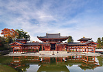 Beautiful Phoenix Hall, Amida hall of Byodoin temple front view, standing under blue sky on Kojima island of Jodoshiki Teien garden pond on a bright sunny autumn day. Uji, Kyoto Prefecture, Japan 2017 Image © MaximImages, License at https://www.maximimages.com