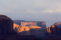 A setting sun lights mesas at the Monument Valley Navajo Tribal Park in southern Utah, Friday, March 10, 2006. The stunning vistas in the park, stars in many John Ford westerns, are an often-forgotten destination for American travelers. (Kevin Moloney for the New York Times)