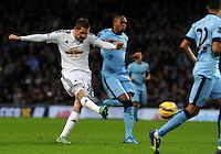 Picture: Andrew Roe/AHPIX LTD, Football, Barclays Premier League, Manchester City v Swansea City, 22/11/14, Etihad Stadium, K.O 3pm<br /> <br /> Swansea's Gylfi Sigurosson fires in a shot on goal<br /> <br /> Andrew Roe>>>>>>>07826527594
