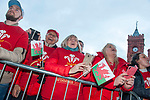 Welsh rugby fans cheer the Wales national rugby team who won both the Six Nations and the Grand Slam are welcomed to the National Assembly for Wales Senedd building in Cardiff Bay today for a public celebration event.