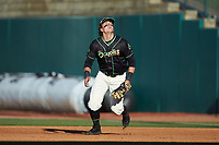 Ocelotes de Greensboro first baseman Mason Martin (35) tracks a pop fly during the game against the Hickory Crawdads at First National Bank Field on June 11, 2019 in Greensboro, North Carolina. The Crawdads defeated the Ocelotes 2-1. (Brian Westerholt/Four Seam Images)