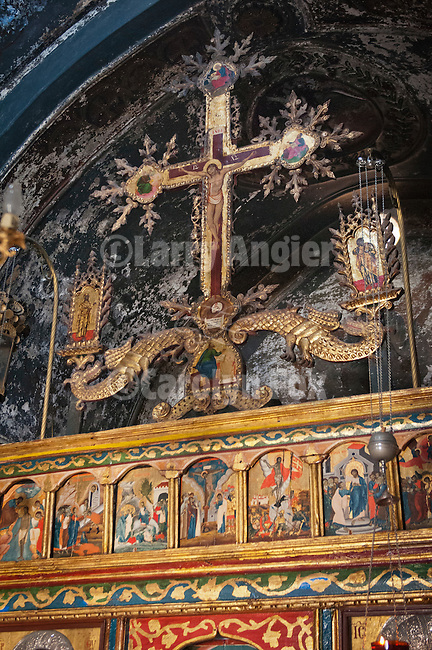 Crucifix at top of iconostasis at altar, interior of small Greek Orthodox chapel, Agios Taxiarchis (Archangels Michael or Gabriel), Naoussa, Greece.