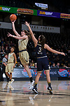 Ivana Raca (11) of the Wake Forest Demon Deacons drives to the basket past Marina Mabrey (3) of the Notre Dame Fighting Irish during first half action at the LJVM Coliseum on December 31, 2017 in Winston-Salem, North Carolina.  The Fighting Irish defeated the Demon Deacons 96-73.  (Brian Westerholt/Sports On Film)