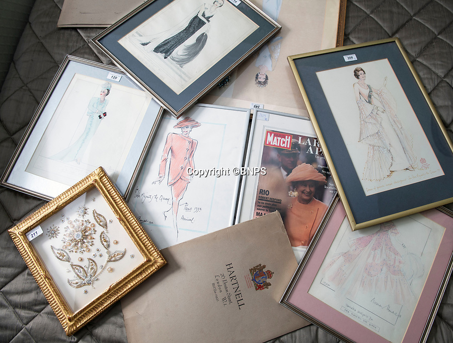 BNPS.co.uk (01202 558833)<br /> Pic: PhilYeomans/BNPS<br /> <br /> Royal dress designs are preserved in picture frames.<br /> <br /> A remarkable 'time warp' Royal archive amassed by the Queen's dressmaker has been found inside his old country home.<br /> <br /> The late Ian Thomas was a dress designer for members of the Royal Family, including Her Majesty, for over 30 years.<br /> <br /> As an apprentice he worked alongside the renowned fashion designer Norman Hartnell on creating the Queen's coronation dress in 1953.<br /> <br /> His archive includes embroidered samples of the gown worn by Elizabeth II for the historic ceremony in Westminster Abbey that was broadcast to millions.<br /> <br /> Mr Thomas also designed outfits for the Queen Mother and Princess Margaret.