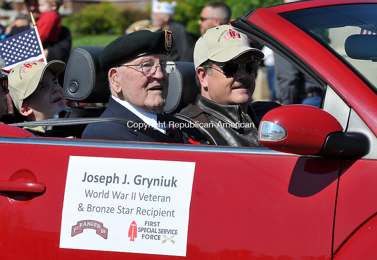TORRINGTON, CT 27 MAY 2013--052713JS19- Joseph J. Gryniuk, UNited States Army WWII Veteran and Bronze Star recipient, rides in the annual Torrington Memorial Day parade on Monday. .Jim Shannon Republican American