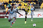 Wellington Phoenix's Nathan Burns, right, hangs in mid air after a collision with Newcastle United's Mapou Yanga-Mbiwa, left, in the fourth match of the Football United Tour at Westpac Stadium, Wellington, New Zealand, Saturday, July 26, 2014. Credit: Dean Pemberton