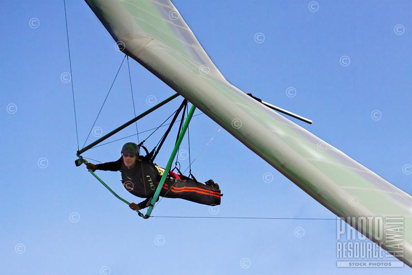 Close-up of a man hang gliding over O'ahu.