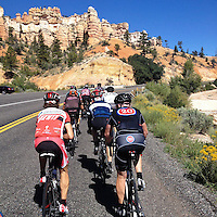 A group of cyclists climbs near the hoodoo formations of Bryce Canyon national Park, Utah.