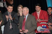 Former Jefferson City High School track and field athletes (left to right) Toby Glavin, Leslie Farmer, Russ Bell, and Jay Shipman clap along with the audience after it's announced that former head track coach and football coach Pete Adkins (center) will be moving into the Legeneds section at the Missouri Sports Hall of Fame , in a ceremony in Jefferson City in April. Adkins led the Jefferson City Jays football program to nine state championships, a national record undefeated streak, and finished with one of the best all-time winnning percentages of any high school football coach in the country.