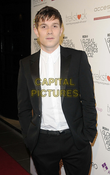 Will Best.The WGSN Global Fashion Awards, Savoy Hotel, The Strand, London, England..November 5th, 2012.half length black suit white shirt hand sin pockets .CAP/CAN.©Can Nguyen/Capital Pictures.