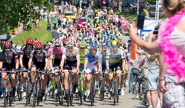 The peloton pass some of the huge crowds during Stage 3 of the 2016 Giro d'Italia running 190km from Nijmegen to Arnhem, The Nethrerlands. 8th May 2016.<br /> Picture: ANSA/Claudio Peri | Newsfile<br /> <br /> <br /> All photos usage must carry mandatory copyright credit (&copy; Newsfile | ANSA/Claudio Peri)