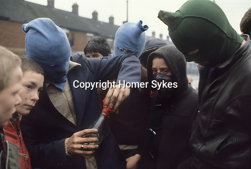Riots rioting Catholic youth attacking the British army Belfast Northern Ireland Uk 1980s