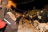 Mitch Seavey arrives at the finish line in Nome, setting a new record of 61:29:45 for the 2008 All Alaska Sweepstakes sled dog race.
