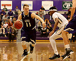 SIOUX FALLS, SD - DECEMBER 31: Zach Wessels #11 from the University of Sioux Falls drives against Nolen Gerald #11 from Augustana University during their game Sunday afternoon December 31, 2017 at the Stewart Center in Sioux Falls, SD.  (Photo by Dave Eggen/Inertia)