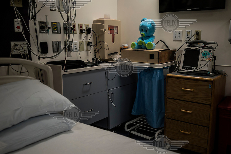 The Huggable Bear sits in an empty room at Boston's Children Hospital in Boston, Massachusetts.  Huggable is a social robotic protoype that is being used in an experiment between Boston's Childen Hospital and the Massachusetts Institute of Technology (MIT). The goal of the experiment is to determine whether the robot can have therapeutic value for children who have to endure long hospital stays. The bear's talking and movements are remotely controlled by Hospital Staff from outside of the room.