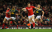 2nd December 2017, Principality Stadium, Cardiff, Wales; Autumn International Rugby Series, Wales versus South Africa; Hallam Amos of Wales evades the attempted tackle by Andries Coetzee of South Africa