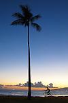 The sunsets over Magic Island on Honolulu, Hawaii.
