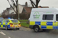 "COPY BY TOM BEDFORD<br /> Pictured: A police car pulls out a speed camera van that got stuck on a grass verge in the village of Laleston, Bridgend, Wales, UK.<br /> Re: A speed camera van that got itself firmly wedged on top of a roadside verge had to be towed free by police – much to the amusement of a passing motorist.<br /> The comical scene was captured on camera by a driver from Bridgend.<br /> He was passing through the village of Laleston, Bridgend when he saw the Ford Transit, in the livery of the GoSafe partnership, in a bit of a pickle.<br /> ""I think they must have tried to get onto the old concrete slab which I think was an old bus stop,"" said the man, who did not wish to be named.<br /> ""But I think he tried to go over the high curb and got stuck."""