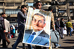 A pro-Mubarak demonstrator with a portrait of Hosni Mubarak near Tahrir Square, Cairo, Egypt, Feb. 2, 2011. Protesters supporting Mubarak marched onto the square, the site where hundreds of thousands of demonstrators gathered yesterday to demand President Hosni Mubarak step down.