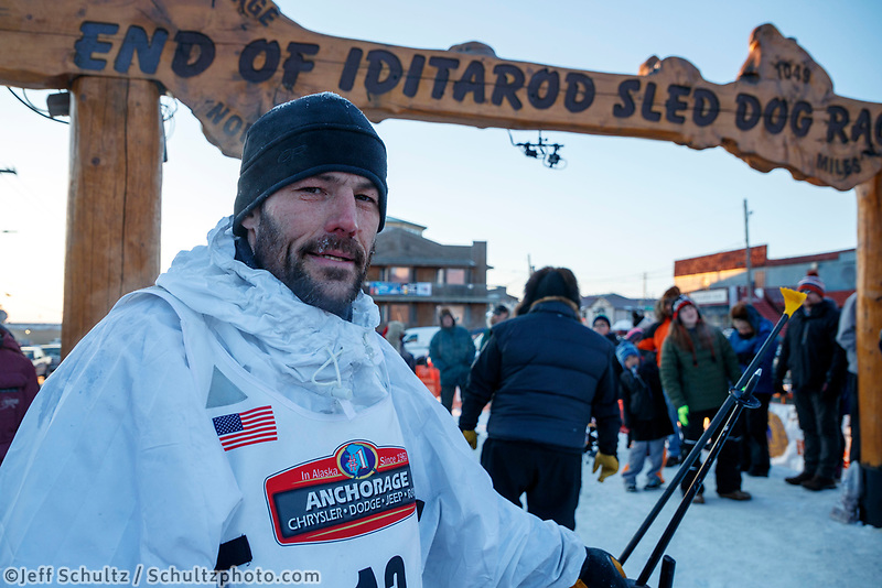 Sebastien Vergnaud at the finish line in Nome during the 2017 Iditarod on Wednesday March 15, 2017.<br /> <br /> Photo by Jeff Schultz/SchultzPhoto.com  (C) 2017  ALL RIGHTS RESERVED