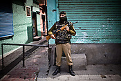 A soldier from the paramilitary force, Central Reserve Police Force (CRPF) is seen guarding the streets on empty streets in the downtown area of Nowhatta, Srinagar, summer capital of Jammu and Kashmir, India. A 50 hour curfew was imposed on May 5th to boycott the elections on May 7, 2009. ..Kashmir went into polls on the 4th round of Indian general elections. About 26 percent polling was recorded in the Indian parliamentary elections held in Kashmir on Thursday, May 7th 2009. The poll percentage was on the higher side this year as compared to 2004 polls when 15.04 percent polling was recorded.