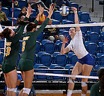 BROOKINGS, SD - SEPTEMBER 30:  Carley Gerving #9 from South Dakota State tries to get a kill past Jenni Fassbender #13 and Emily Minnick #3 from North Dakota State in the fourth game of their match Tuesday night at Frost Arena in Brookings. (Photo/Dave Eggen/Inertia)