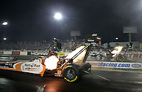 Apr. 5, 2013; Las Vegas, NV, USA: NHRA top fuel dragster driver Clay Millican (near) races alongside teammate Bob Vandergriff Jr during qualifying for the Summitracing.com Nationals at the Strip at Las Vegas Motor Speedway. Mandatory Credit: Mark J. Rebilas-