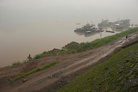 Daytime landscape view of the river boats docked on the Cháng Jiāng and shoreline in Jiāngyáng Qū of the Lúzhōu Prefecture City in Sichuan Province.  © LAN